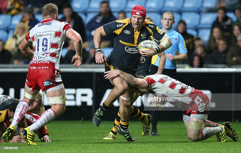 James Haskell of Wasps is tackled during the Aviva Premiership match between Wasps and Gloucester at The Ricoh Arena on November 8, 2015 in Coventry, England.