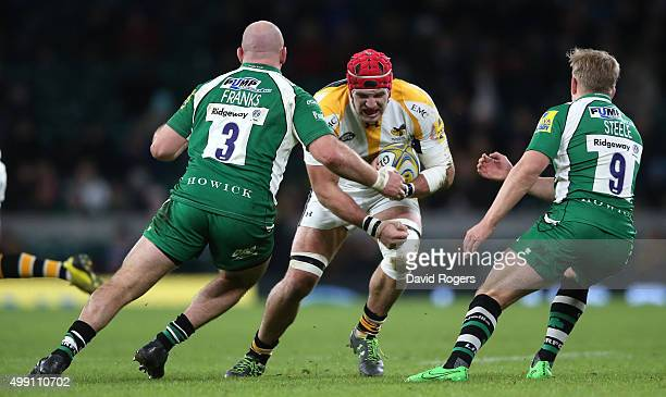 James Haskell of Wasps takes on Ben Franks and Scott Steele during the Aviva Premiership match between London Irish and Wasps at Twickenham Stadium...