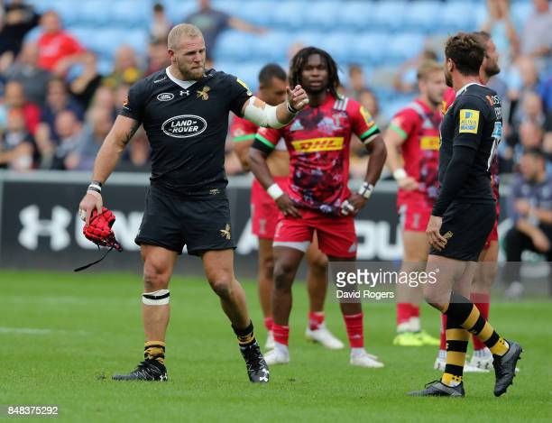 James Haskell of Wasps walks off the pitch after being shown the yellow card for fighting with Harlequins prop Joe Marler during the Aviva...