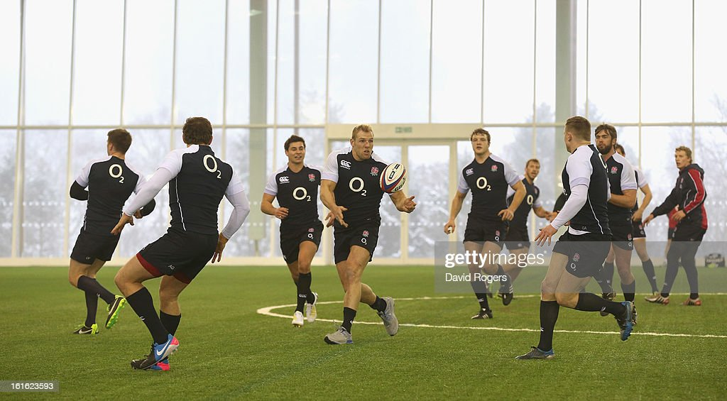 James Haskell passes the ball during the England training session held at St Georges Park on February 13, 2013 in Burton-upon-Trent, England.