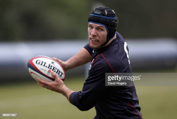 James Haskell passes the ball during the England training session held at Pennyhill Park on February 23, 2010 in Bagshot, England.