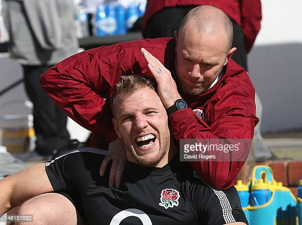 James Haskell receives has his neck manipulated by England physiotherapist Dan Lewindon during the England training session held at St. David's...