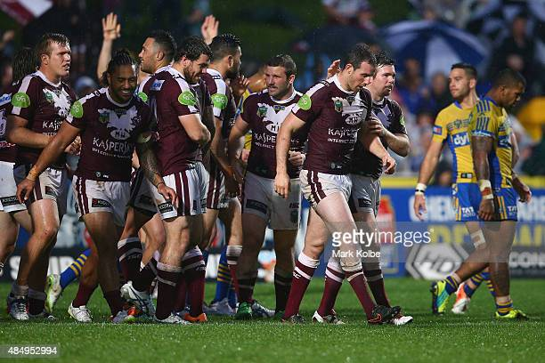 James Hasson of the Eagles celebrates with his team mates after scoring a try during the round 24 NRL match between the Manly Warringah Sea Eagles...