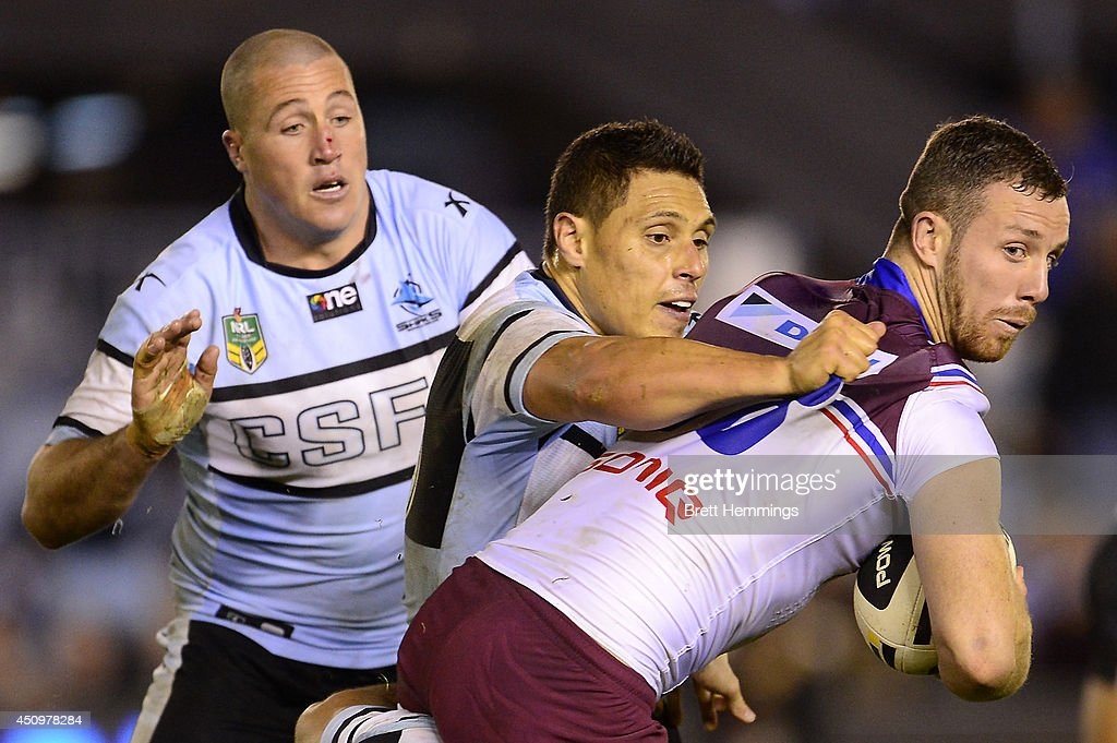 James Hasson of the Sea Eagles is tackled during the round 15 NRL match between the Cronulla-Sutherland Sharks and the Manly-Warringah Sea Eagles at Remondis Stadium on June 21, 2014 in Sydney, Australia.