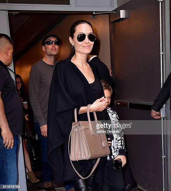 James Haven and Angelina Jolie leave Broadway musical Hamilton at Richard Rodgers Theatre on June 19 2016 in New York City