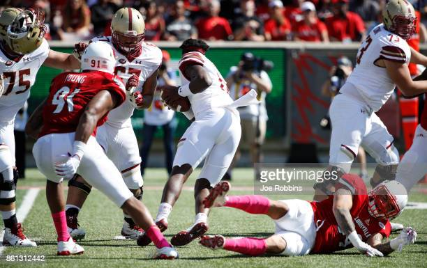 James Hearns of the Louisville Cardinals sacks Anthony Brown of the Boston College Eagles as he loses his helmet in the second quarter of a game at...