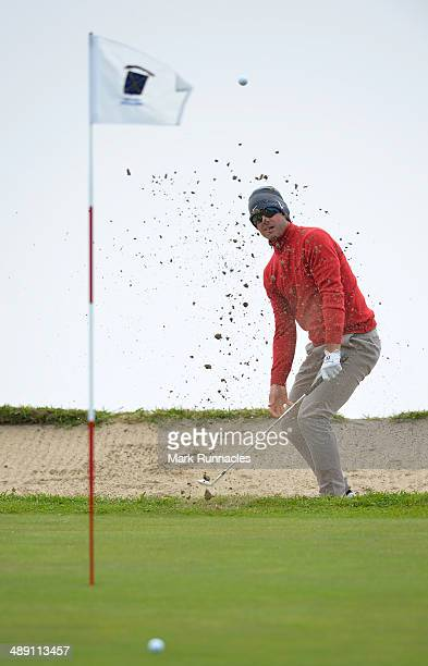 James Heath of England plays a bunker shot to the 4th green during the Madeira Islands Open - Portugal - BPI at Club de Golf do Santo da Serra on May...