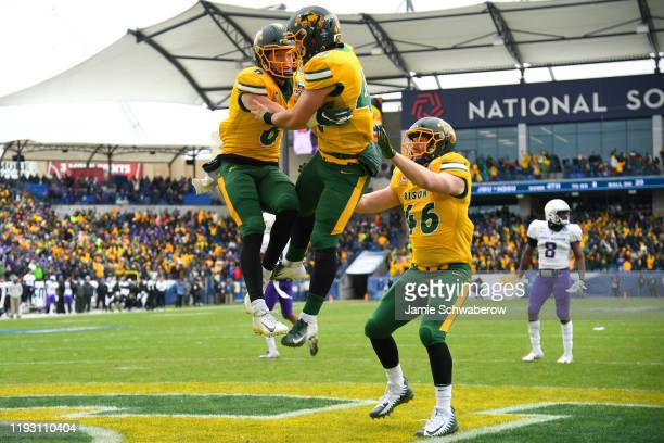 James Hendricks and Ross Kennelly of the North Dakota State Bison celebrate after a touchdown on a fake field goal against the James Madison Dukes...