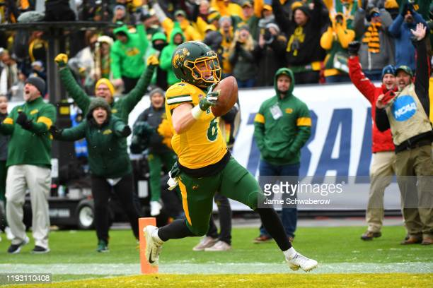 James Hendricks of the North Dakota State Bison celebrates his touchdown on a fake field goal against the James Madison Dukes during the Division I...