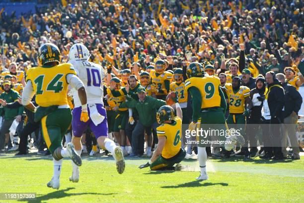 James Hendricks of the North Dakota State Bison intercepts a pass in the closing seconds of the game to defeated the James Madison Dukes during the...