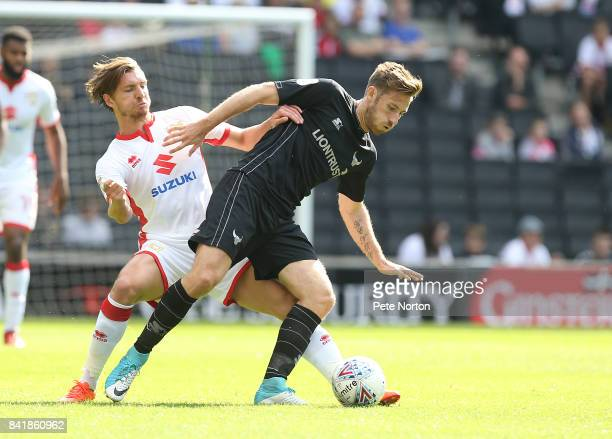 James Henry of Oxford United attempts to control the ball under pressure from Alex Gilbey of Milton Keynes Dons during the Sky Bet League One match...