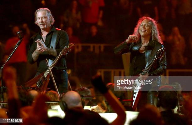 "James Hetfield and Kirk Hammett of Metallica perform with the San Francisco Symphony during the ""S&M2"" concerts at the opening night at Chase Center..."