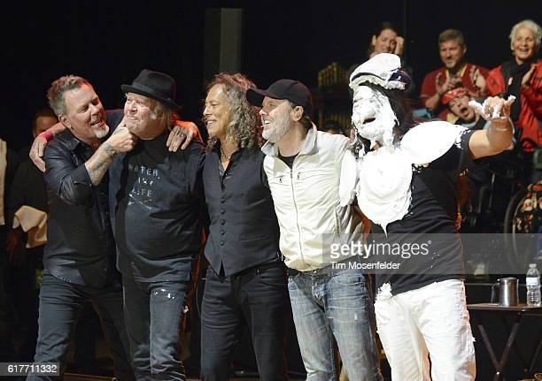 James Hetfield Neil Young Kirk Hammett Lars Ulrich and Robert Trujillo of Metallica celebrate Robert's birthday during the 30th Annual Bridge School...