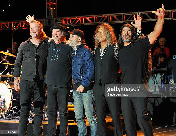 James Hetfield of Metallica poses with Neil Young and Metallica band members Lars Ulrich Kirk Hammett and Robert Trujillo at the 30th Annual Bridge...