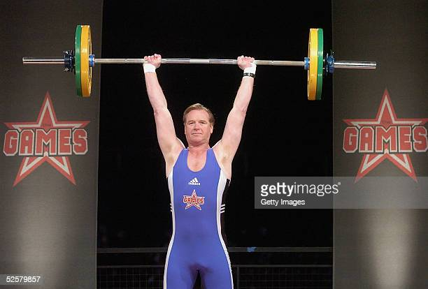 James Hewitt competes in the weightlifting event at 'The Games Champion of Champions' final contest at the Don Valley Stadium on April 2 2005 in...
