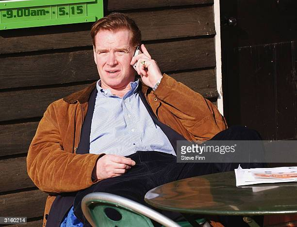 James Hewitt speaks on his mobile phone while sitting on a bench in Hyde Park on March 30 2004 in London