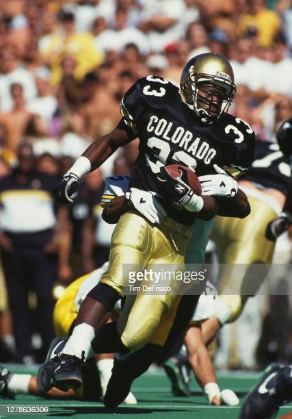 James Hill, Running Back for the University of Colorado Buffaloes runs the football during the NCAA Big Ten college football game against the Iowa...