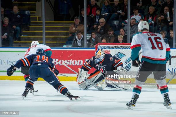 James Hilsendager of the Kelowna Rockets skates toward Dylan Ferguson on a third period break away with Connor Zary of the Kamloops Blazers in...