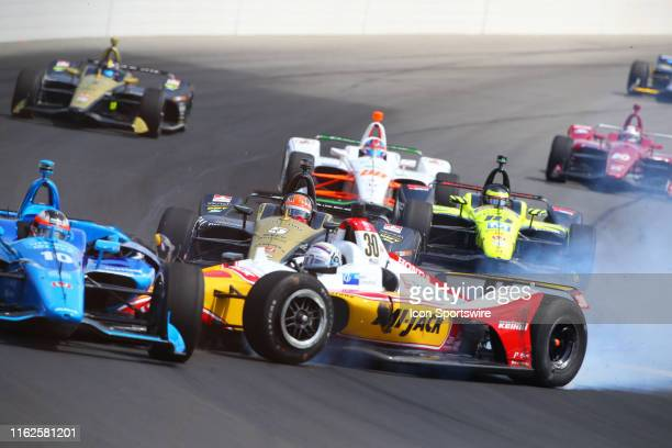 James Hinchcliffe driver of the Arrow Schmidt Peterson Motorsports Honda drives during the opening lap as Takuma Sato driver of the MiJack /...