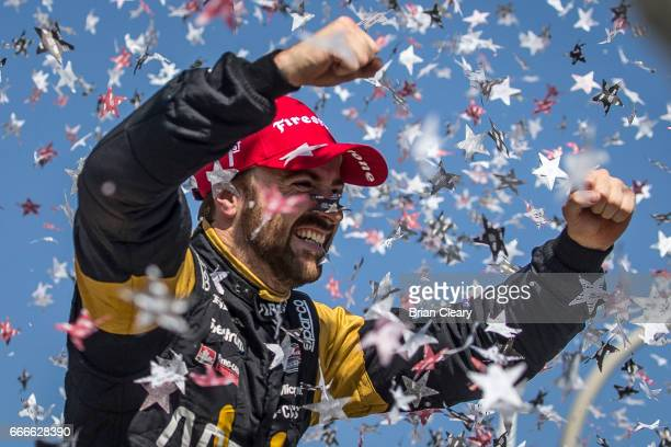 James Hinchcliffe of Canada celebrates in victory lane after winning the Grand Prix at Long Beach IndyCar race on April 9 2017 in Long Beach...