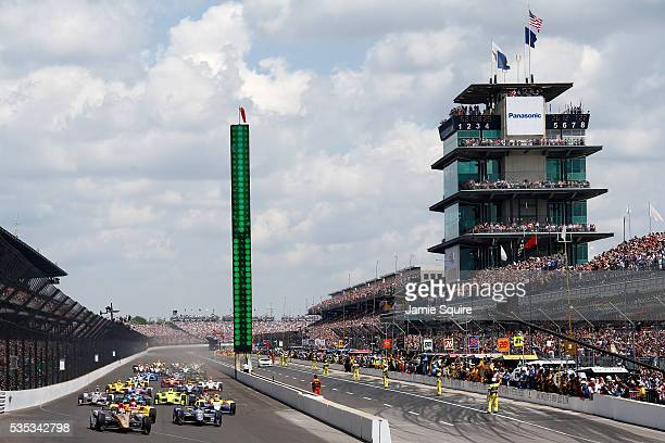 James Hinchcliffe of Canada driver of the ARROW Schmidt Peterson Motorsports Chevrolet leads the field at the start of the 100th running of the...