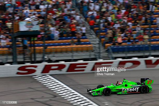 James Hinchcliffe of Canada driver of the GoDaddy Andretti Autosport Chevrolet celebrates as he crosses the finish line in the Iowa Corn Indy 250 at...