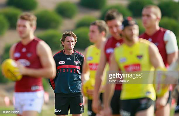 James Hird coach of the Bombers looks on as his players train during an Essendon Bombers AFL training session at True Value Solar Centre on April 2...