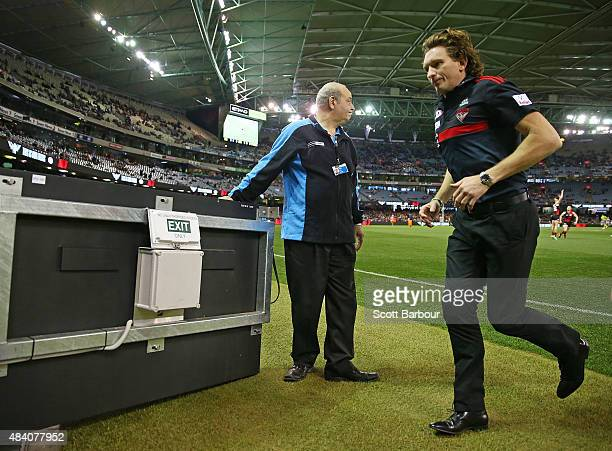 James Hird coach of the Essendon Bombers walks to the coaches box during the round 20 AFL match between the Essendon Bombers and the Adelaide Crows...