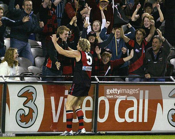 James Hird for the Bombers celebrates with a fan during the round three AFL match between the Essendon Bombers and the West Coast Eagles at the...