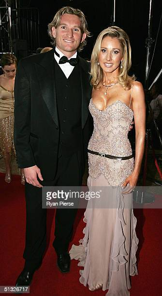 James Hird of Essendon and his wife Tanya arrive for the Brownlow Medal Dinner at the Crown Casino on September 20 2004 in Melbourne Australia