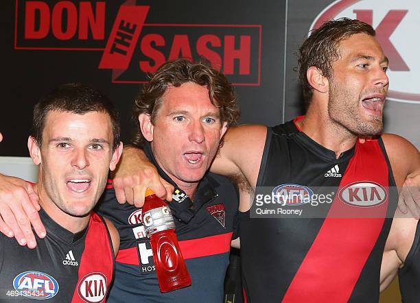 James Hird the coach of the bombers sings the song with Brent Stanton and Tom Bellchambers of the Bombers after winning the round two AFL match...