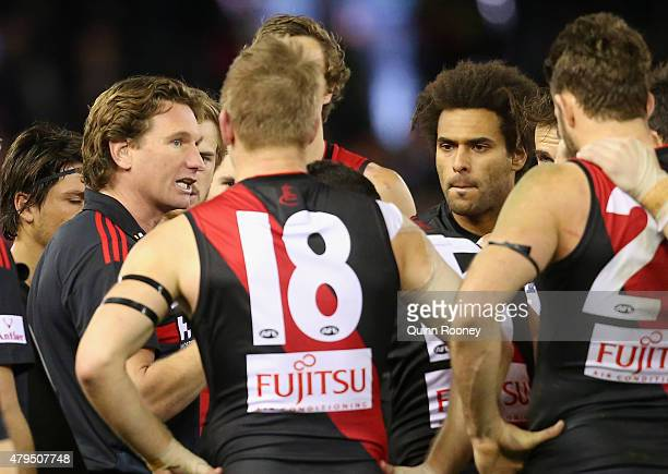 James Hird the coach of the Bombers talks to his players during the round 14 AFL match between the Essendon Bombers and the St Kilda Saints at Etihad...