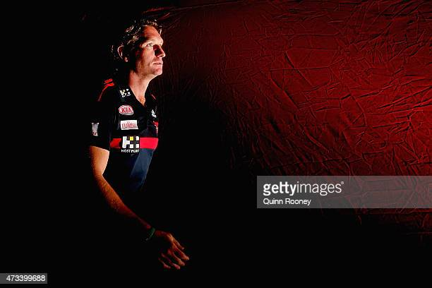 James Hird the coach of the Bombers walks out onto the field during the round seven AFL match between the Essendon Bombers and the North Melbourne...
