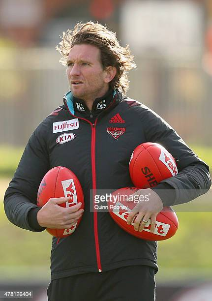 James Hird the coach of the Bombers watches on during an Essendon Bombers AFL training session at True Value Solar Centre on June 23 2015 in...