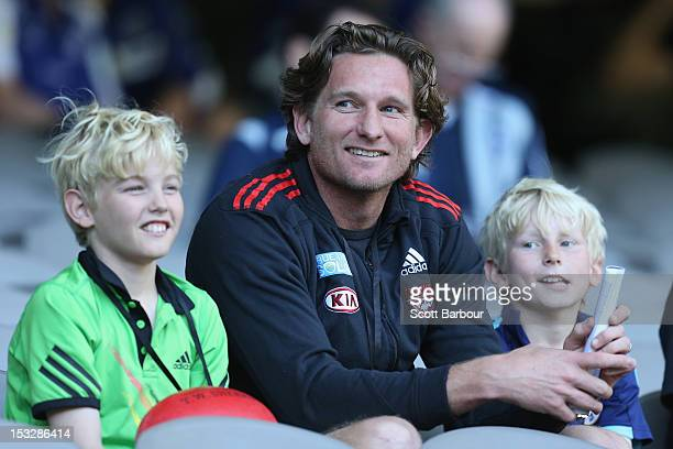 James Hird the coach of the Essendon Bombers looks on with his sons Tom and Alex during the 2012 AFL Draft Combine at Etihad Stadium on October 3...