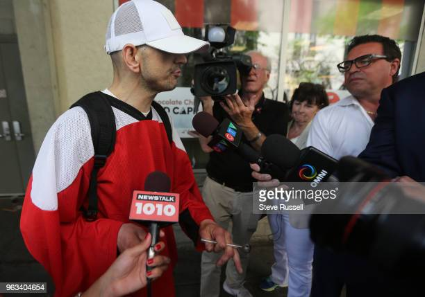 TORONTO ON MAY 28 James holding a crack pipe talks to City Councillor Giorgio Mammoliti Mammoliti visited the safe injection site near YongeDundas as...