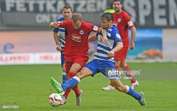 James Holland of Duisburg tackles Christoph Hemlein of Bielefeld during the Second Bundesliga match between MSV Duisburg and Arminia Bielefeld at...