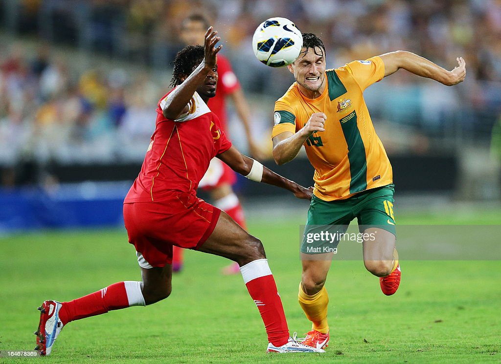 James Holland of the Socceroos is challenged by Ahmed Mubarak of Oman during the FIFA 2014 World Cup Qualifier match between the Australian Socceroos and Oman at ANZ Stadium on March 26, 2013 in Sydney, Australia.