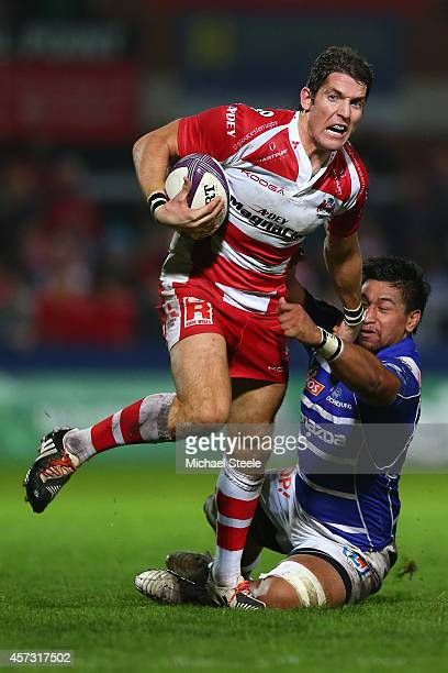 James Hook of Gloucester bursts past the challenge from Poutasi Luafutu of Brive during the European Rugby Challenge Cup Pool 5 match between...