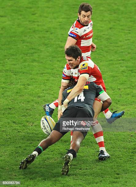 James Hook of Gloucester is tackled by Marland Yarde of Harlequins during the Aviva Premiership Big Game 9 match between Harlequins and Gloucester...