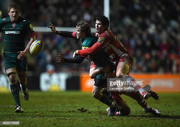 James Hook of Gloucester Rugy tackles Matthew Tait of Leicester during the Aviva Premiership match between Leicester Tigers and Gloucester Rugby at...