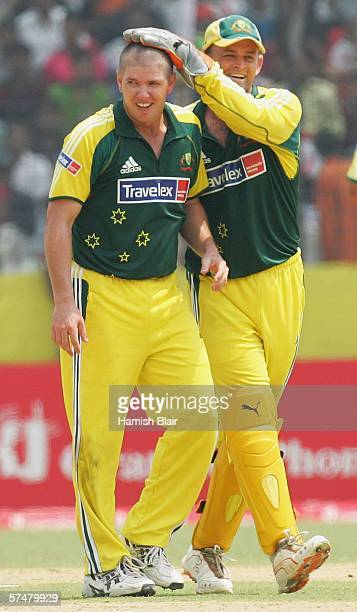 James Hopes of Australia is congratulated by team mate Adam Gilchrist on the wicket of Mohammad Ashraful of Bangladesh during the 3rd One Day...