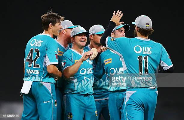 James Hopes of the Heat celebrates with team mates after taking the final wicket by running out Gurinder Sandhu of the Thunder during the Big Bash...