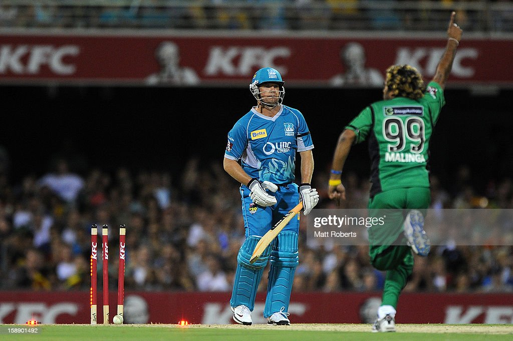 James Hopes of the Heat is bowled by Lasith Malinga of the Stars during the Big Bash League match between the Brisbane Heat and the Melbourne Stars at The Gabba on January 3, 2013 in Brisbane, Australia.