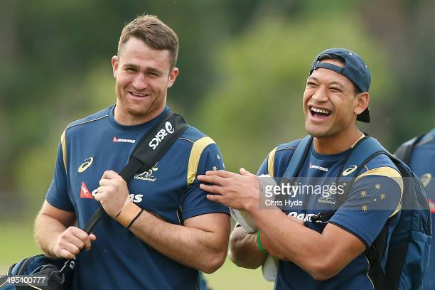 James Horwill and Israel Folau share a joke during an Australian Wallabies training session at Sanctuary Cove on June 3 2014 in Gold Coast Australia