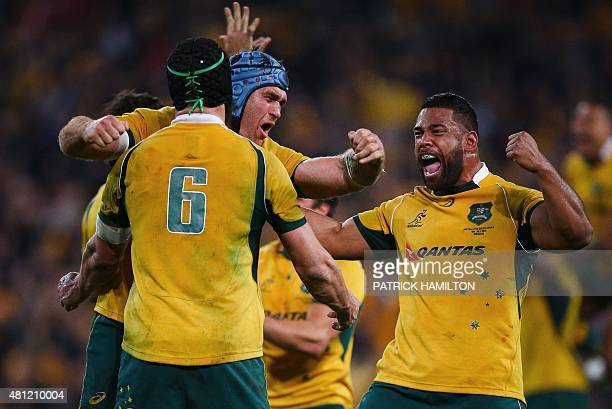 James Horwill embraces Scott Fardy and Tatafu PolotaNau of Australia as they celebrate their victory after the Rugby Championship Test match between...