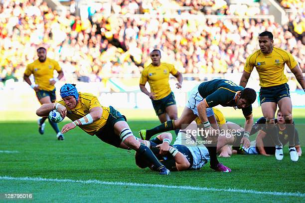 James Horwill of Australia goes over the line to score their first try during quarter final three of the 2011 IRB Rugby World Cup between South...
