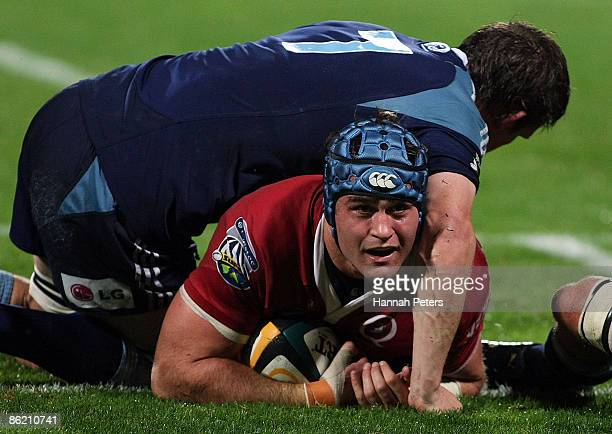 James Horwill of the Reds dives over to score a try during the round 11 Super 14 match between the Blues and the Reds at North Harbour Stadium on...