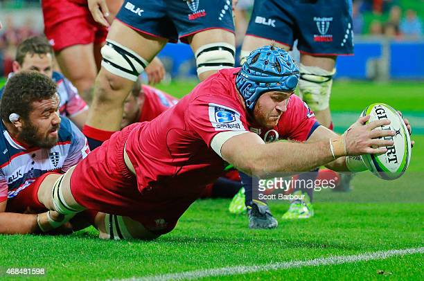 James Horwill of the Reds dives to score a try during the round eight Super Rugby match between the Rebels and the Reds at AAMI Park on April 3 2015...