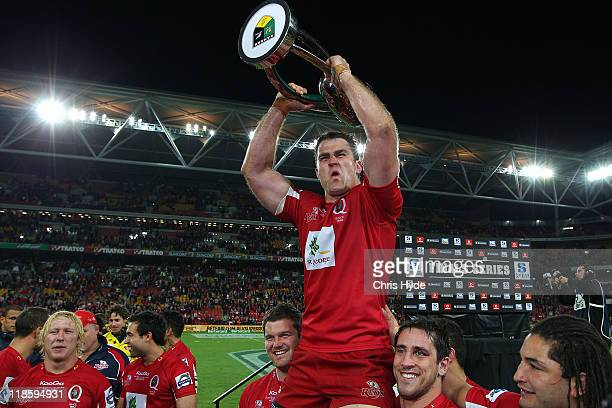 James Horwill of the Reds holds the winners trophy after the 2011 Super Rugby Grand Final match between the Reds and the Crusaders at Suncorp Stadium...